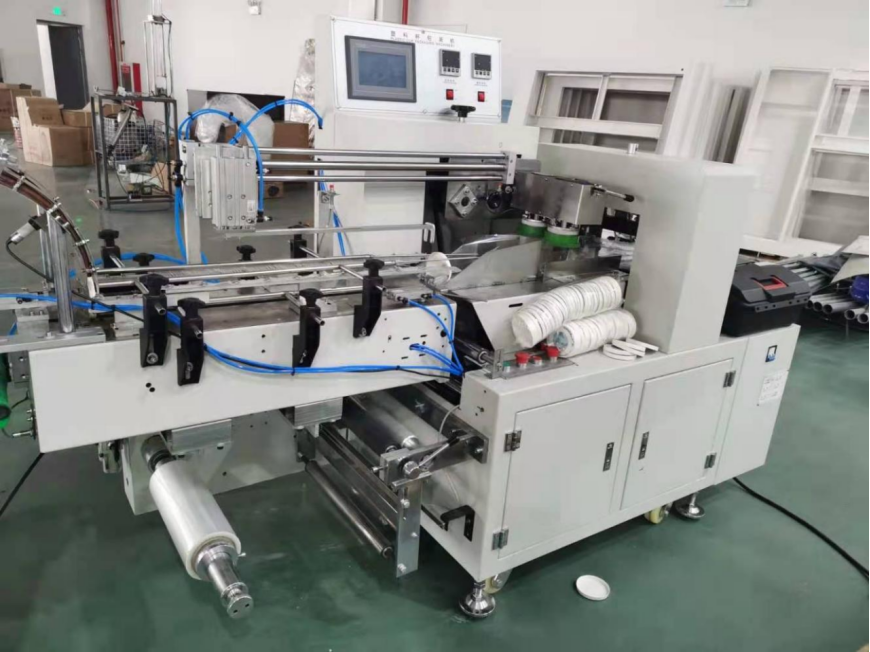 Paper cup lid packing machine inline with paper cup lid machine